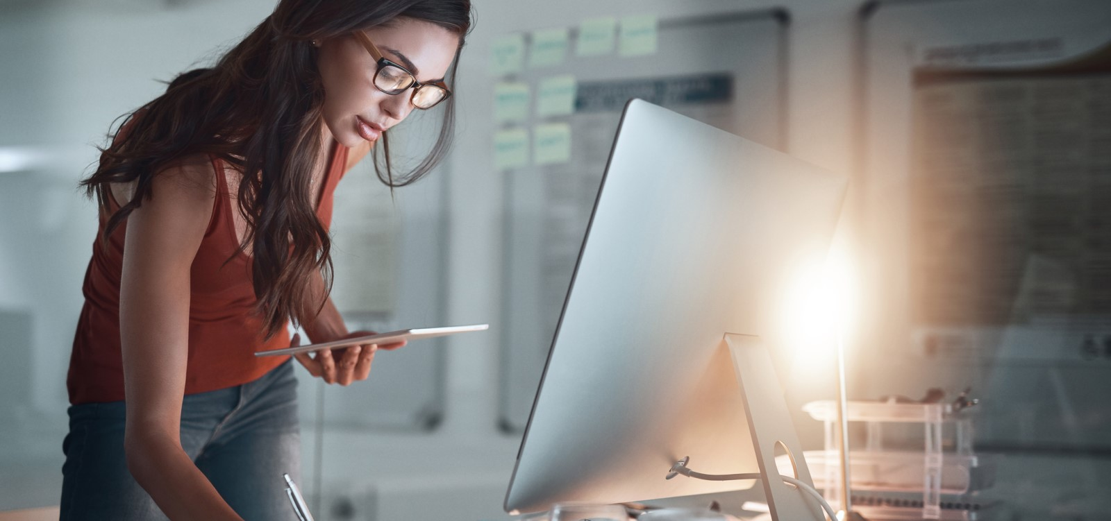 business woman taking notes | payroll sales rep standing out in the professional services industry