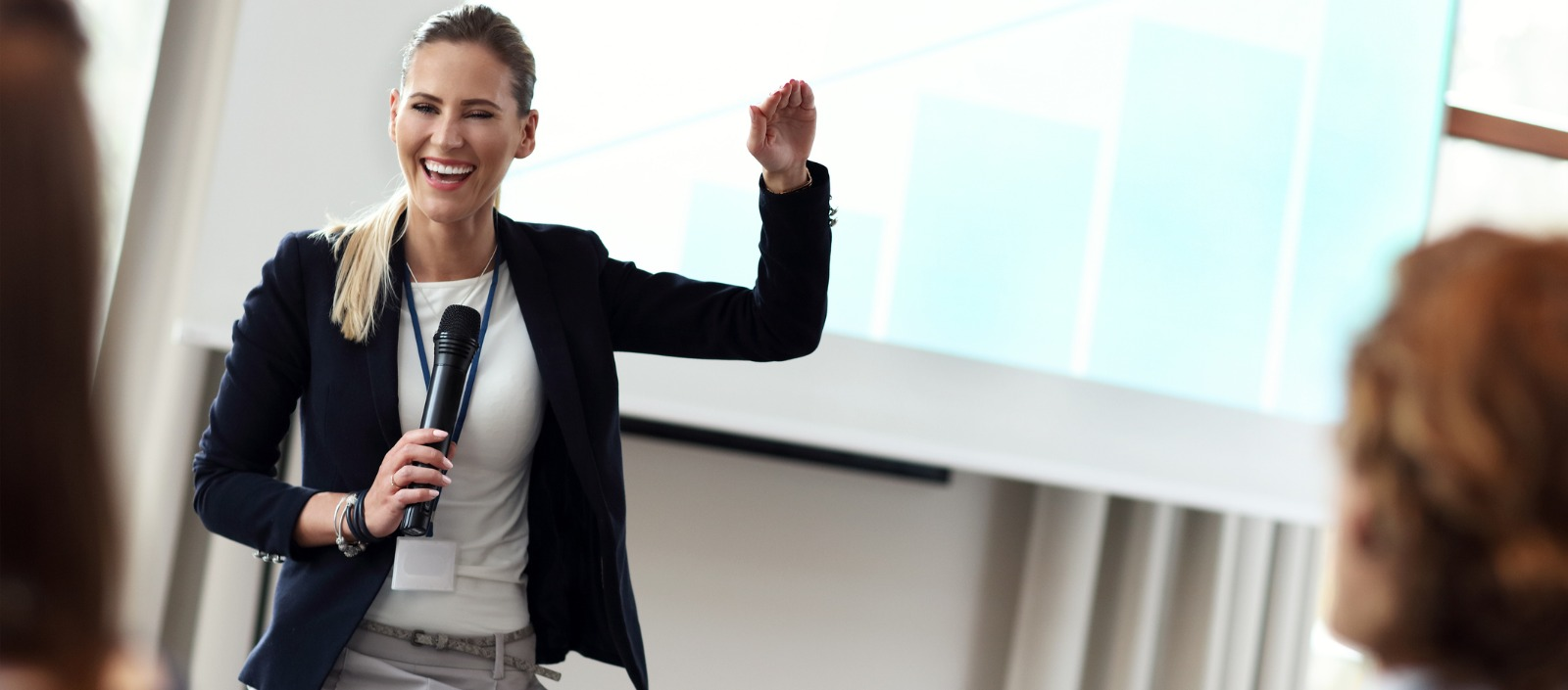 woman speaking at a conference | how to do a virtual conference