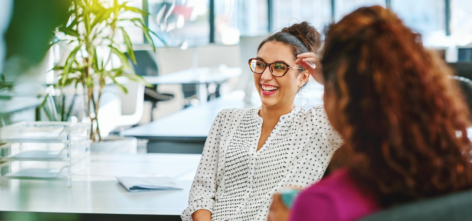 office colleagues talking and smiling | on-demand pay model