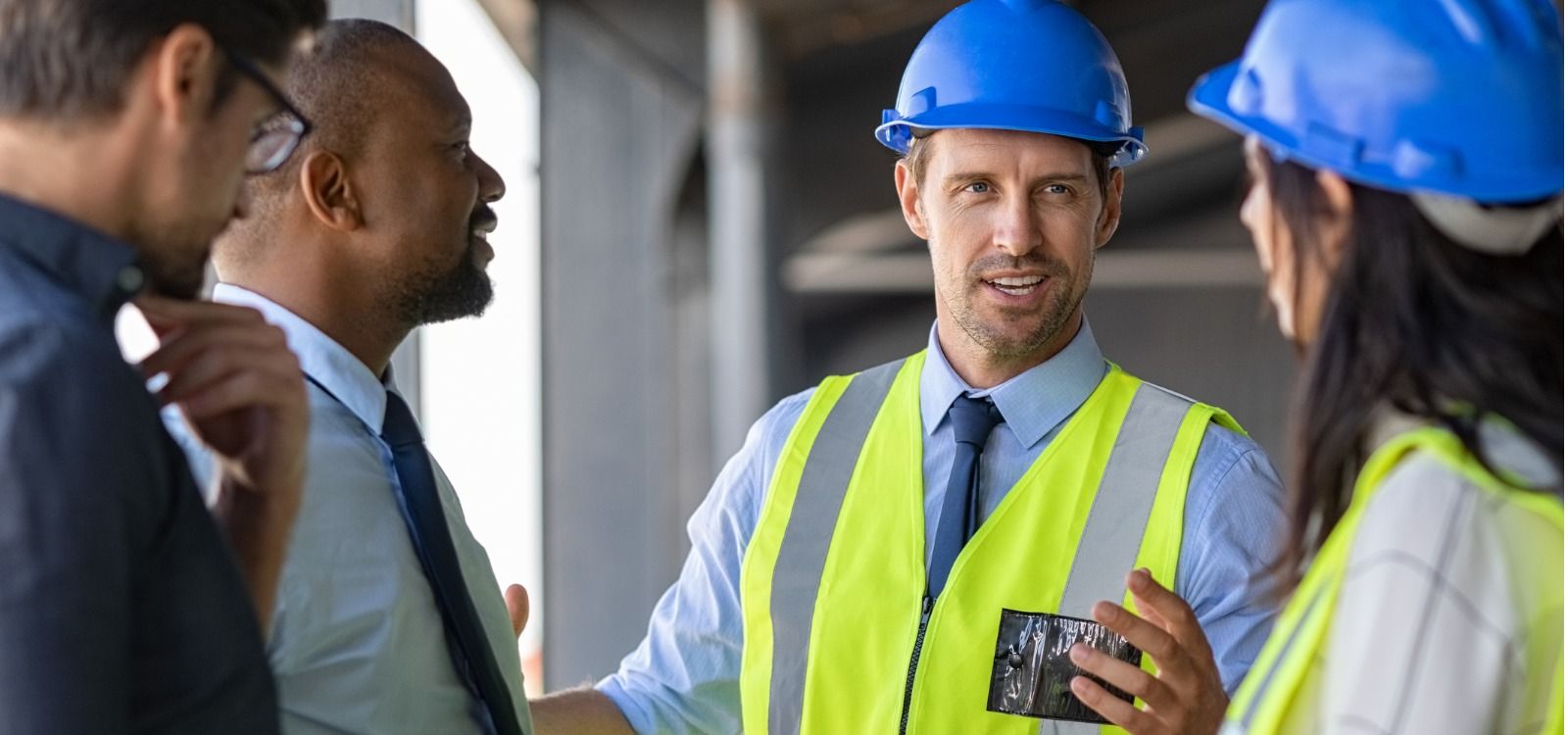construction workers discussing a project at a construction site | Contractor Central 2.0 selling tool