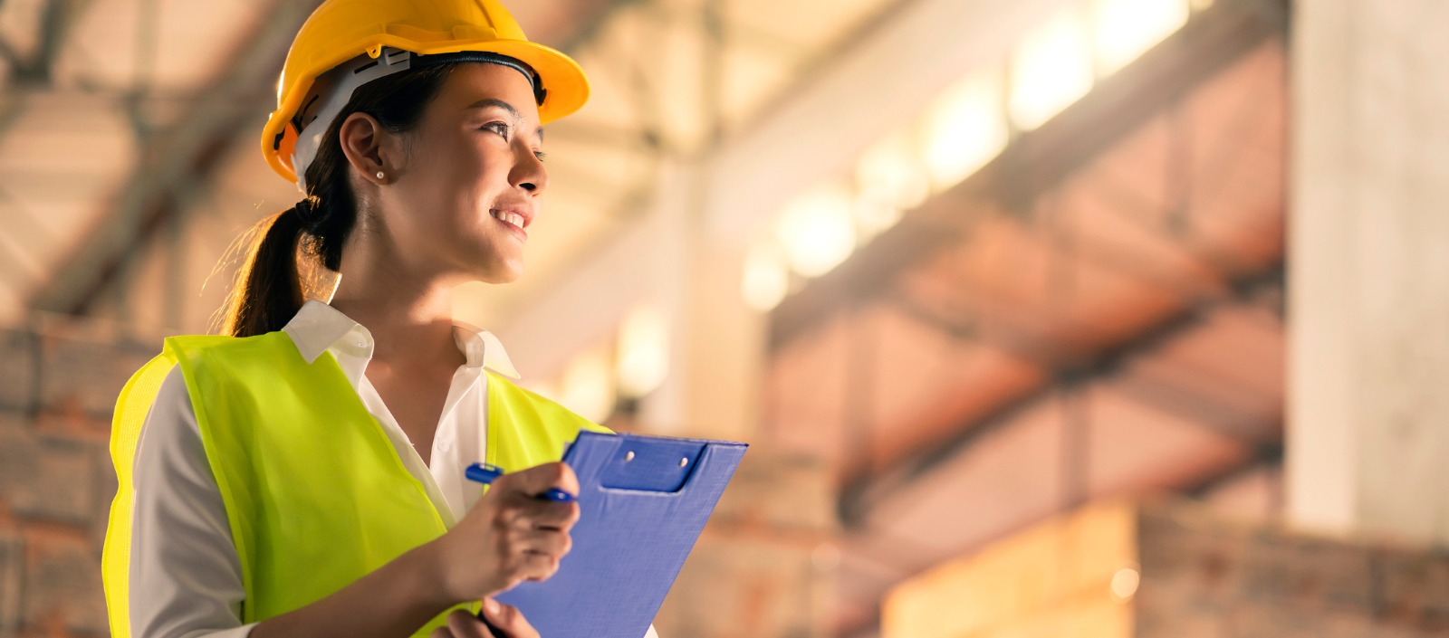 Female construction worker smiling | Contractor Central for construction payroll customers