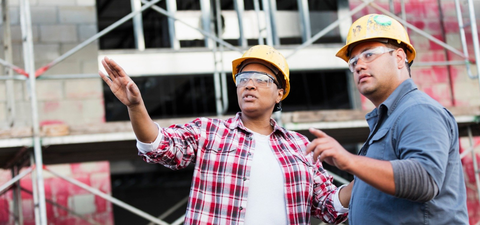 two construction workers discussing a project | Contractor Central 2.0